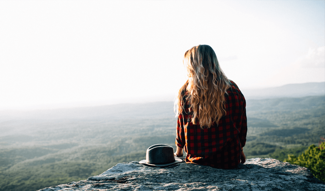 woman alone on mountain top