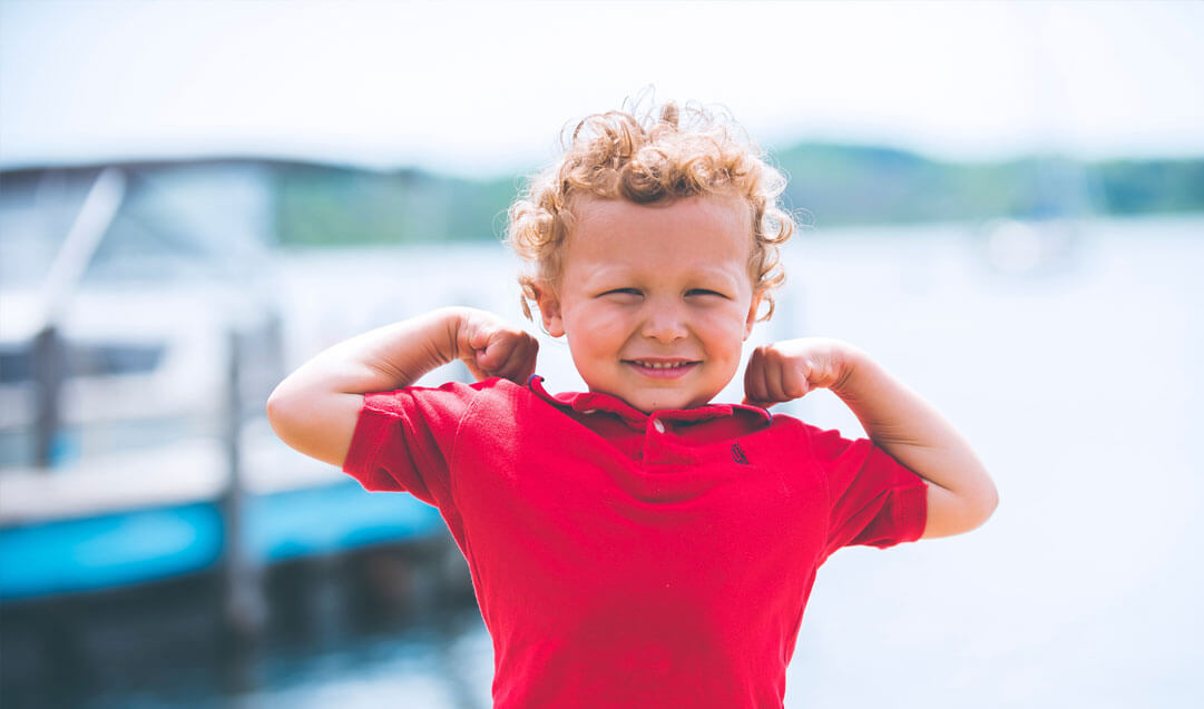 little toddler flexing arms
