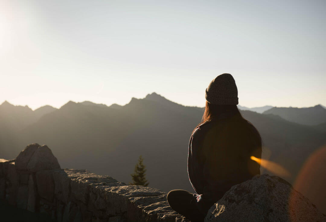 woman on mountain meditating