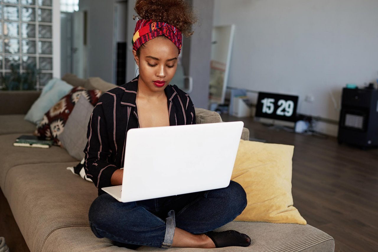 woman sitting with laptop on lap